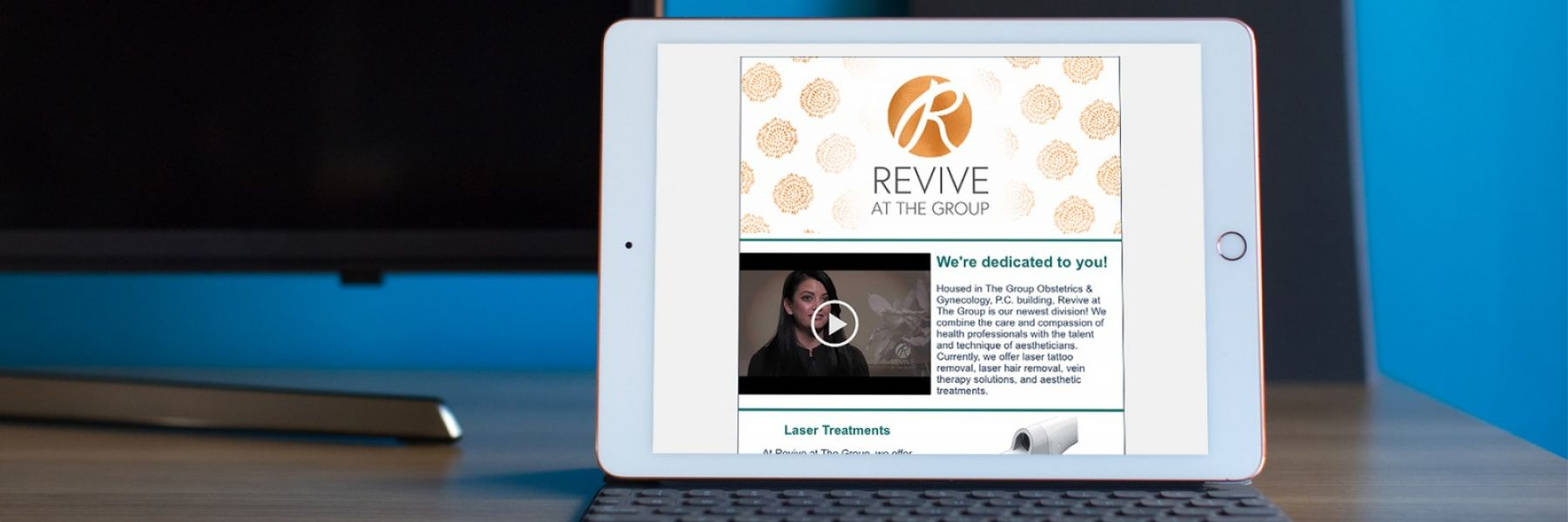 Email sent from Revive at The Group to their clients displayed horizontally on a tablet